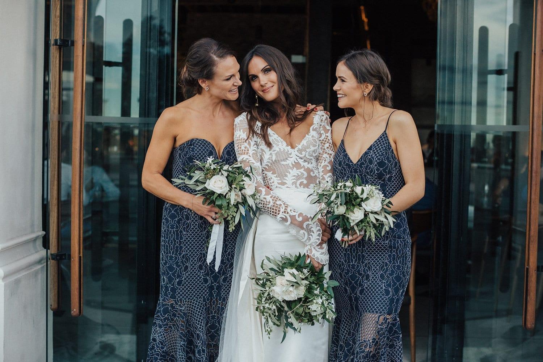 Real Weddings | Vinka Design | Real Brides Wearing Vinka Gowns | Hannah and Campbell - Hannah with bridesmaids