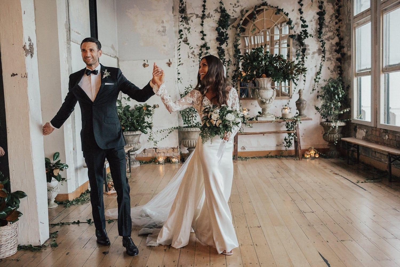 Real Weddings | Vinka Design | Real Brides Wearing Vinka Gowns | Hannah and Campbell walking through reception venue