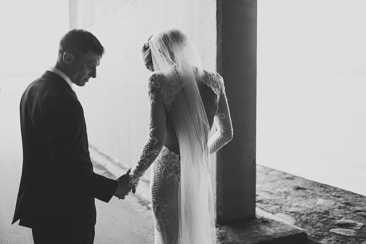 Real Weddings | Vinka Design | Real Brides Wearing Vinka Gowns | Hayley and Tonchi facing away in black and white