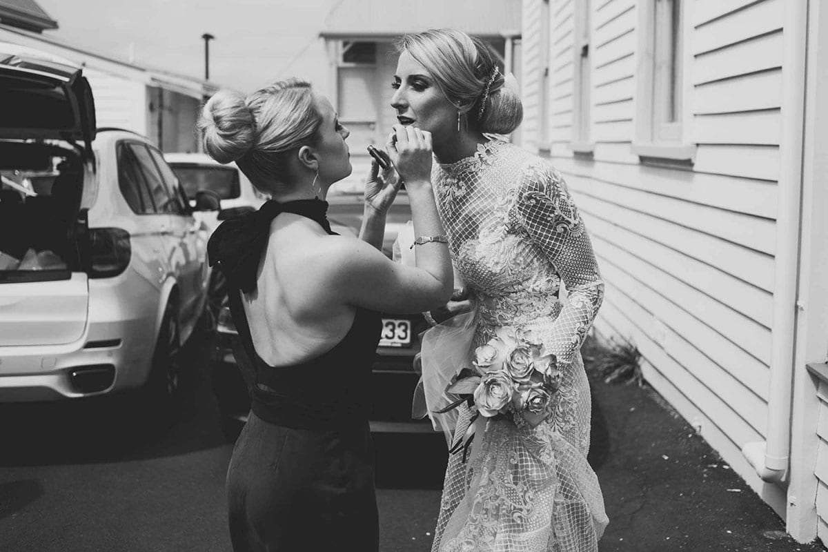 Real Weddings | Vinka Design | Real Brides Wearing Vinka Gowns | Hayley having lipstick touch up in black and white