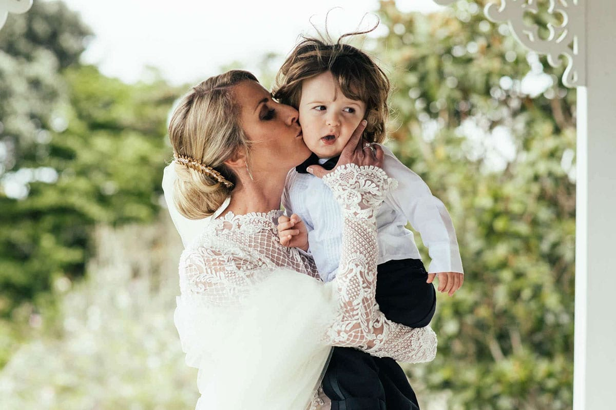 Real Weddings | Vinka Design | Real Brides Wearing Vinka Gowns | Hayley and Tonchi - Hayley kissing child