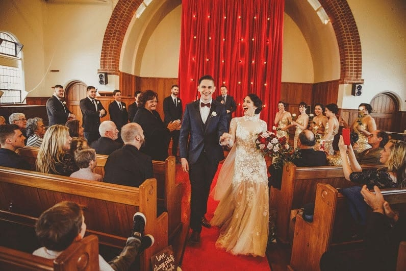 Real Weddings | Vinka Design | Real Brides Wearing Vinka Gowns | Cecilia and Brendan walking down aisle just married
