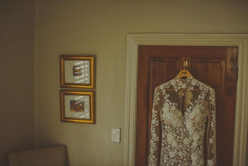 Real Weddings | Vinka Design | Real Brides Wearing Vinka Gowns | Cecilia and Brendan - hanging wedding dress on door