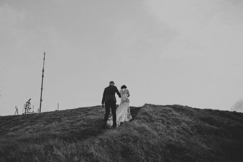 Real Weddings | Vinka Design | Real Brides Wearing Vinka Gowns | Cecilia and Brendan close up black and white - walking up hill