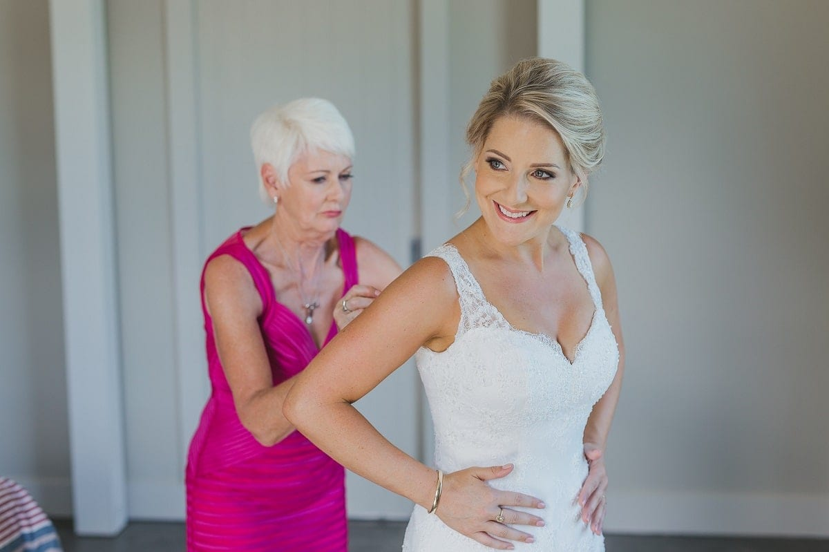 Real Weddings | Vinka Design | Real Brides Wearing Vinka Gowns | Sophie and Auldan - Sophie being helped