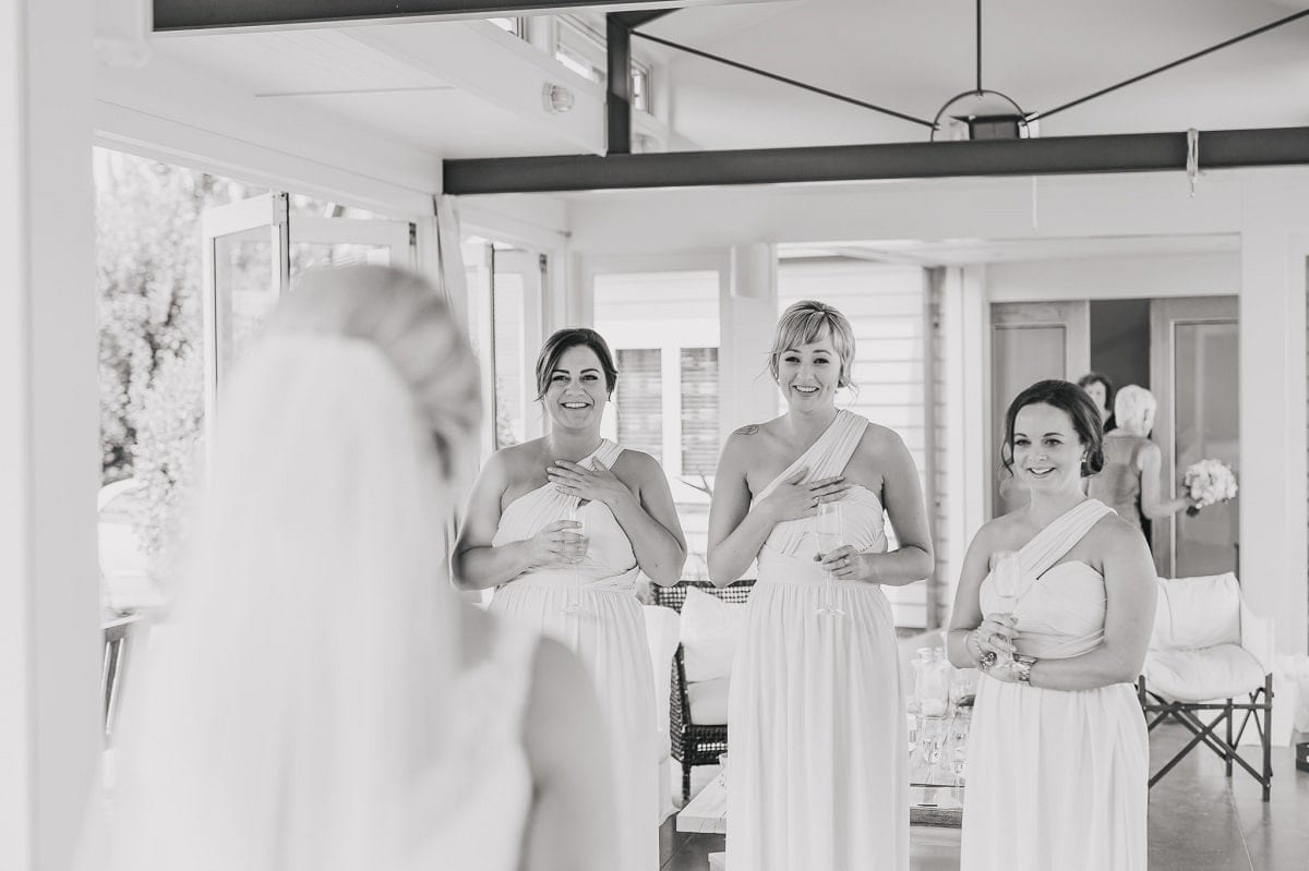 Real Weddings | Vinka Design | Real Brides Wearing Vinka Gowns | Sophie and Auldan - Sophie and bridesmaids looking on holding hearts