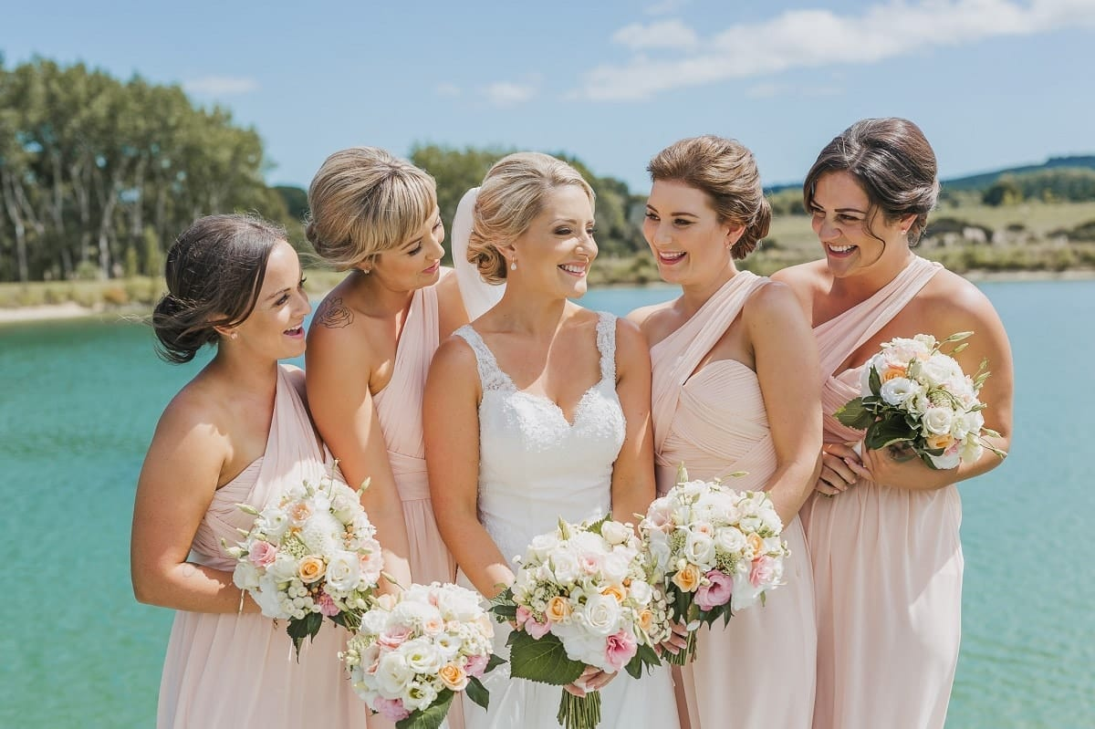 Real Weddings | Vinka Design | Real Brides Wearing Vinka Gowns | Sophie and Auldan - Sophie and bridesmaids in front of lake