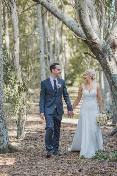 Real Weddings | Vinka Design | Real Brides Wearing Vinka Gowns | Sophie and Auldan walking through forest path