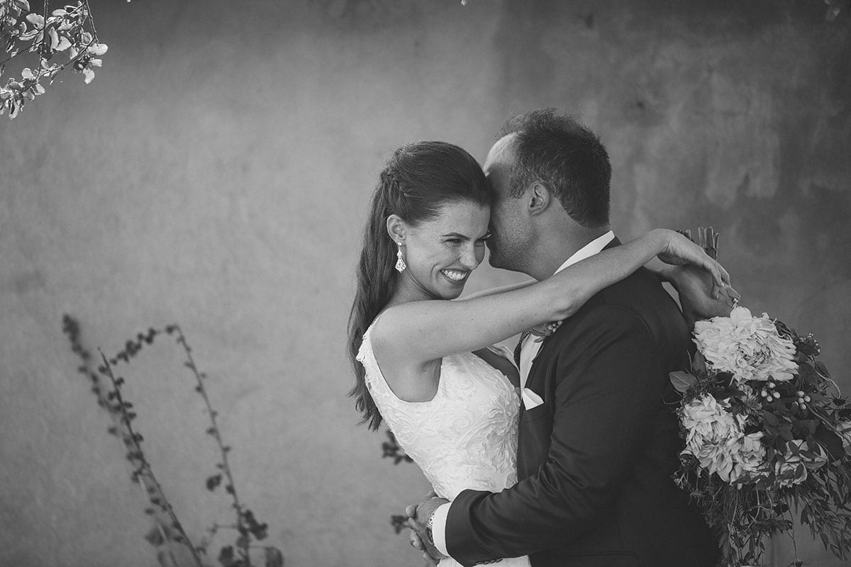 Real Weddings | Vinka Design | Real Brides Wearing Vinka Gowns | Clare and Mark black and white close up laughing