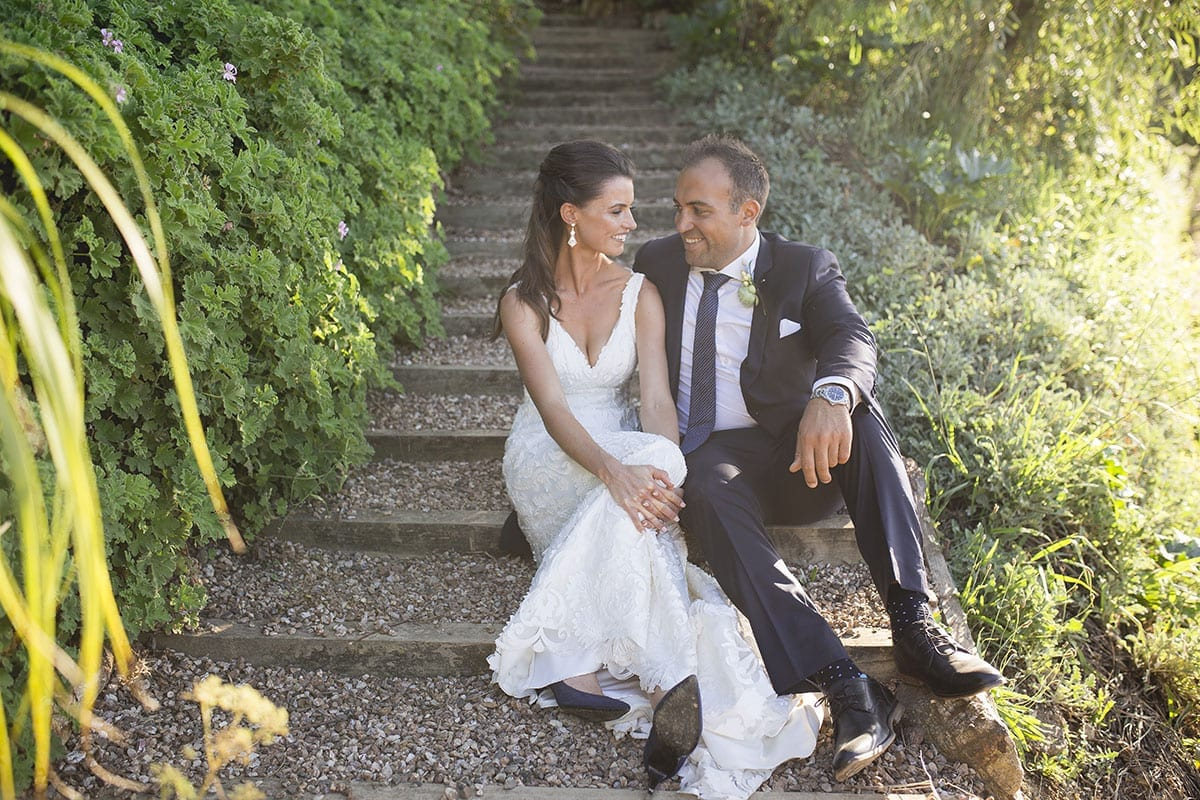 Real Weddings | Vinka Design | Real Brides Wearing Vinka Gowns | Clare and Mark sitting on garden steps