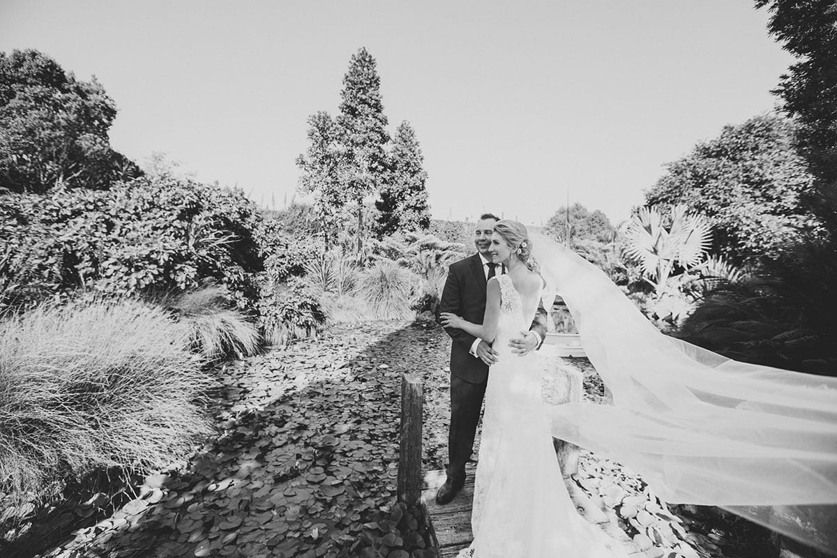 Real Weddings | Vinka Design | Real Brides Wearing Vinka Gowns | Angela and Tony outdoors in black and white