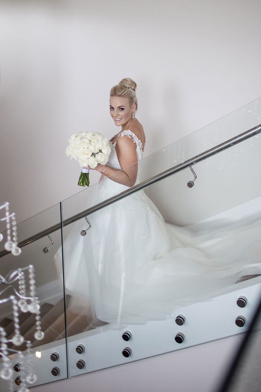 Real Weddings | Vinka Design | Real Brides Wearing Vinka Gowns | Kristen and Ben - Kristen walking down stairs
