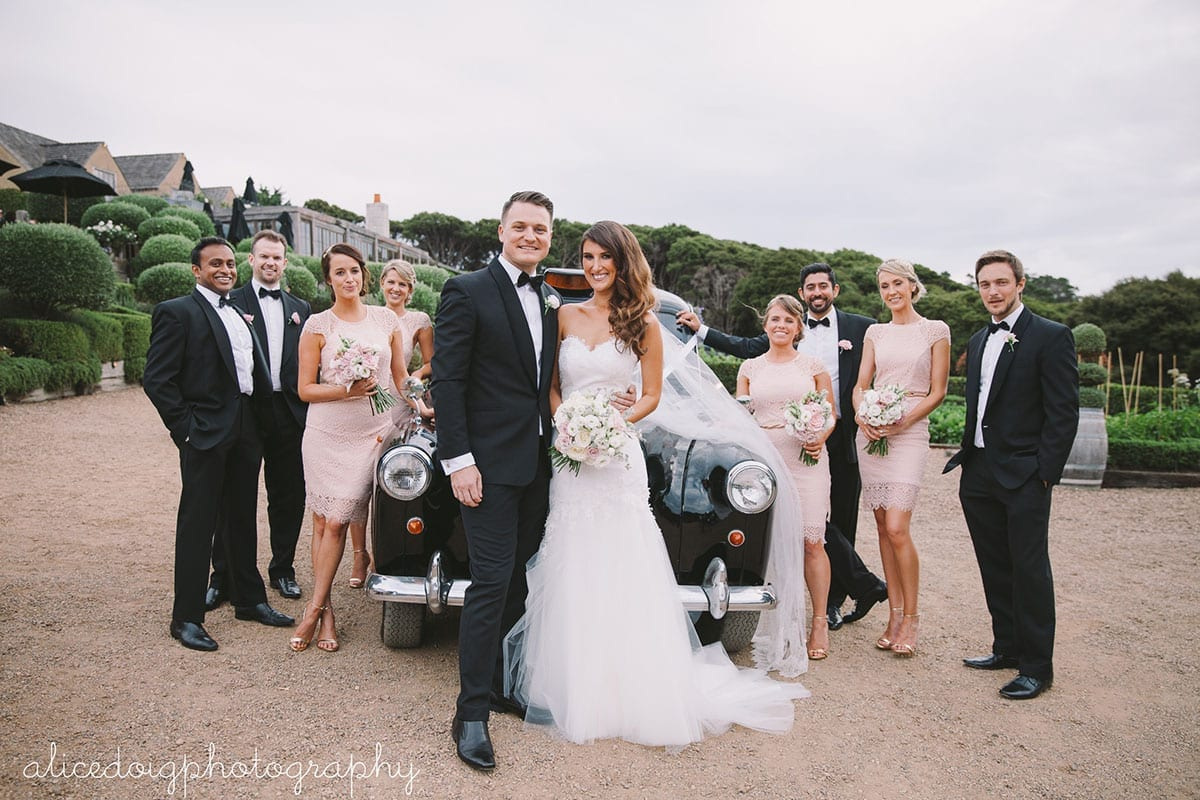 Real Weddings | Vinka Design | Real Brides Wearing Vinka Gowns | Gemma and Colin with bridal party in front of classic car