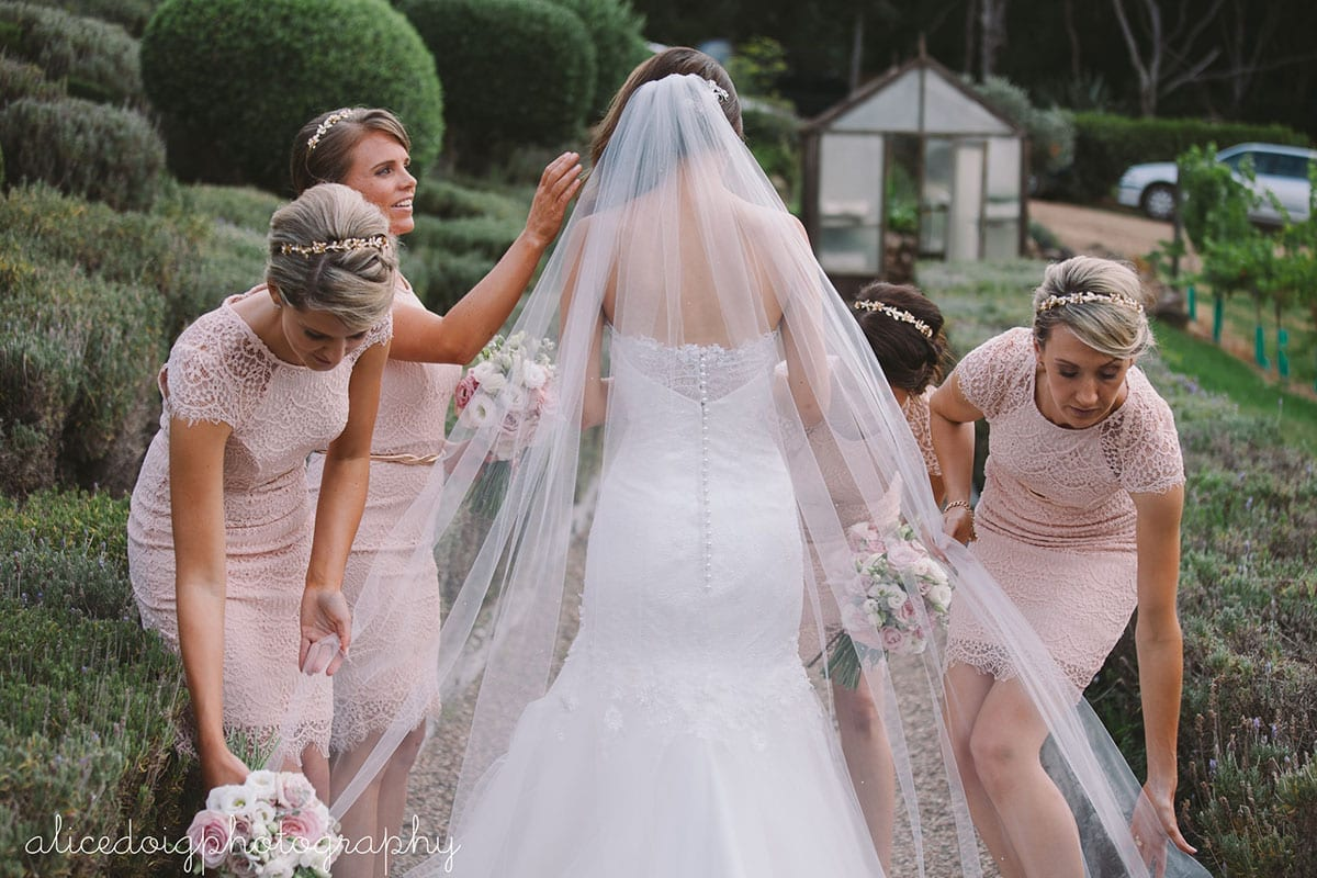 Real Weddings | Vinka Design | Real Brides Wearing Vinka Gowns | Gemma and bridesmaids attending to veil