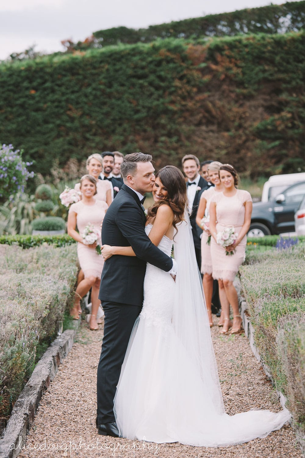 Real Weddings | Vinka Design | Real Brides Wearing Vinka Gowns | Gemma and Colin with bridal party behind