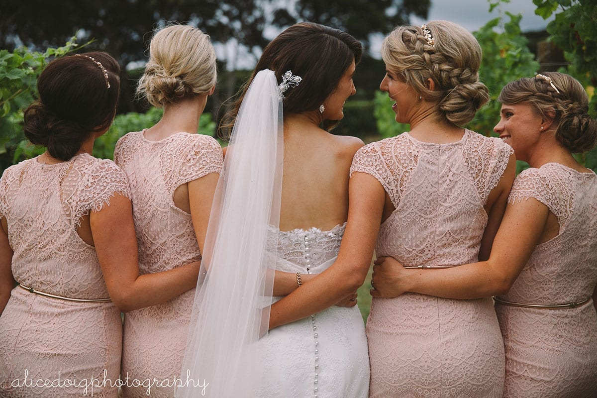 Real Weddings | Vinka Design | Real Brides Wearing Vinka Gowns | Gemma and bridesmaids face away in line showing pearl button detail on back of dress