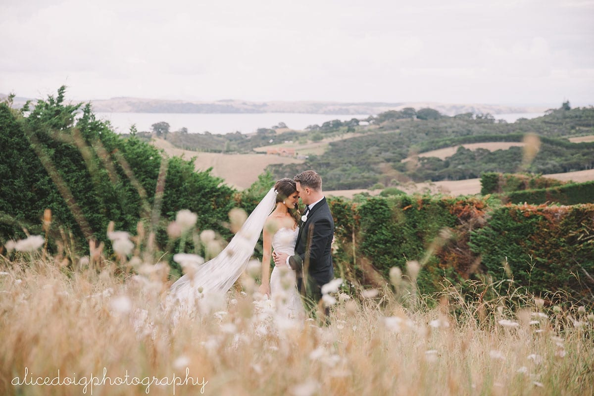 Real Weddings | Vinka Design | Real Brides Wearing Vinka Gowns | Gemma and Colin in wild field on hill face to face