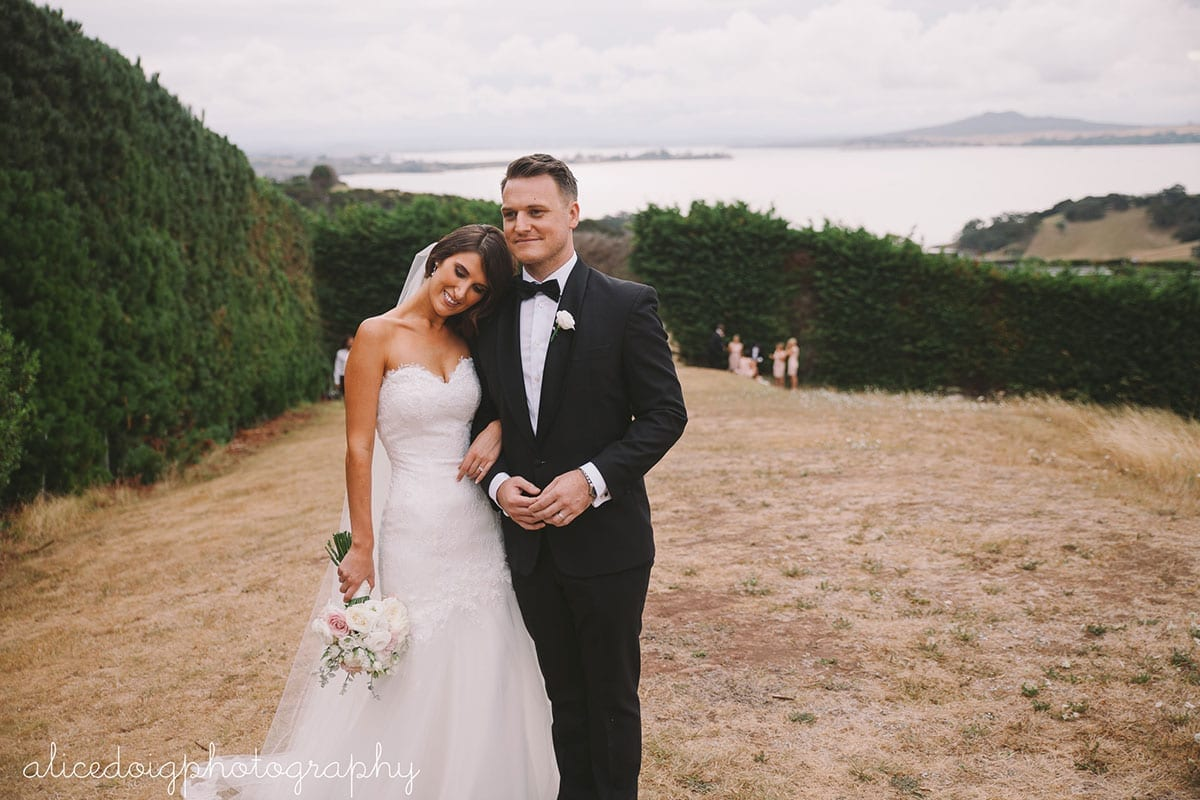 Real Weddings | Vinka Design | Real Brides Wearing Vinka Gowns | Gemma and Colin outdoors arm in arm