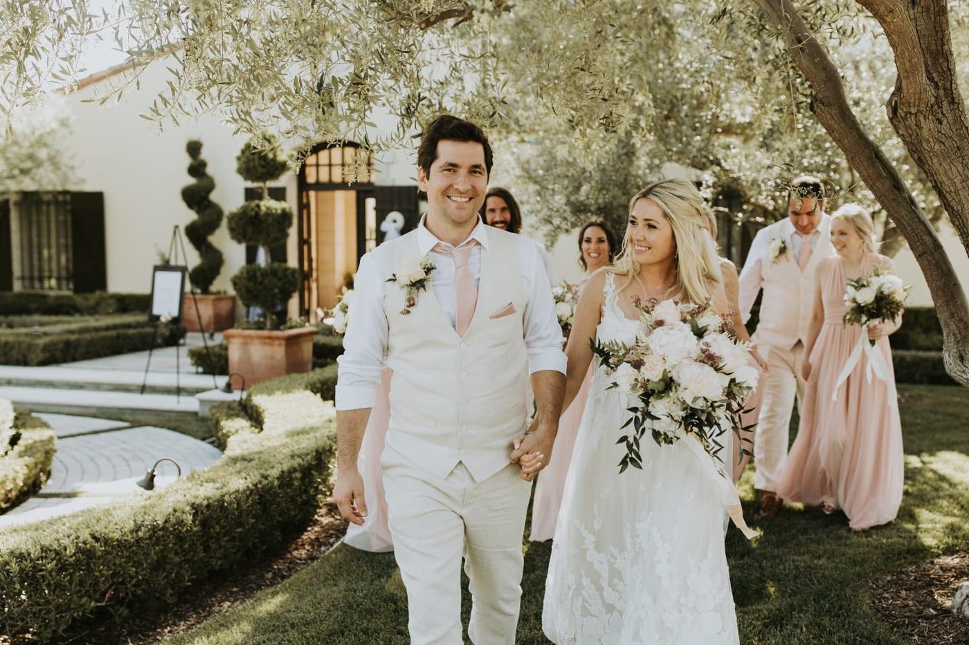 Real Weddings | Vinka Design | Real Brides Wearing Vinka Gowns | Camille and Aaron walking through beautiful groundsa
