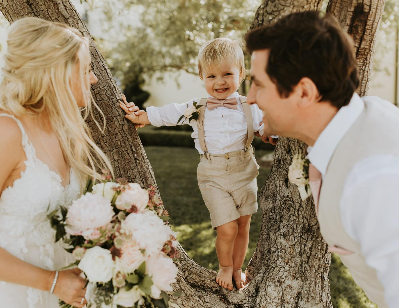 Real Weddings | Vinka Design | Real Brides Wearing Vinka Gowns | Camille and Aaron with little boy in tree