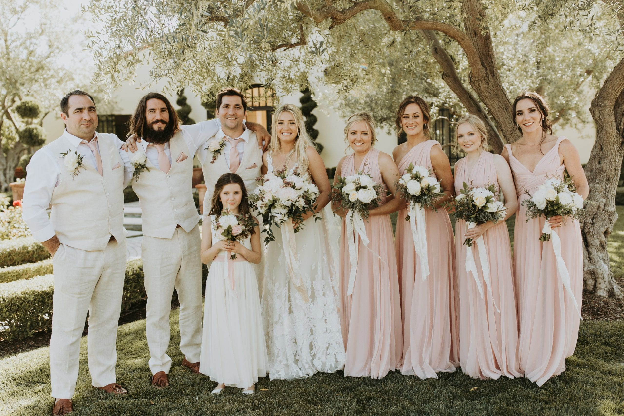 Real Weddings | Vinka Design | Real Brides Wearing Vinka Gowns | Camille and Aaron with bridal party under trees