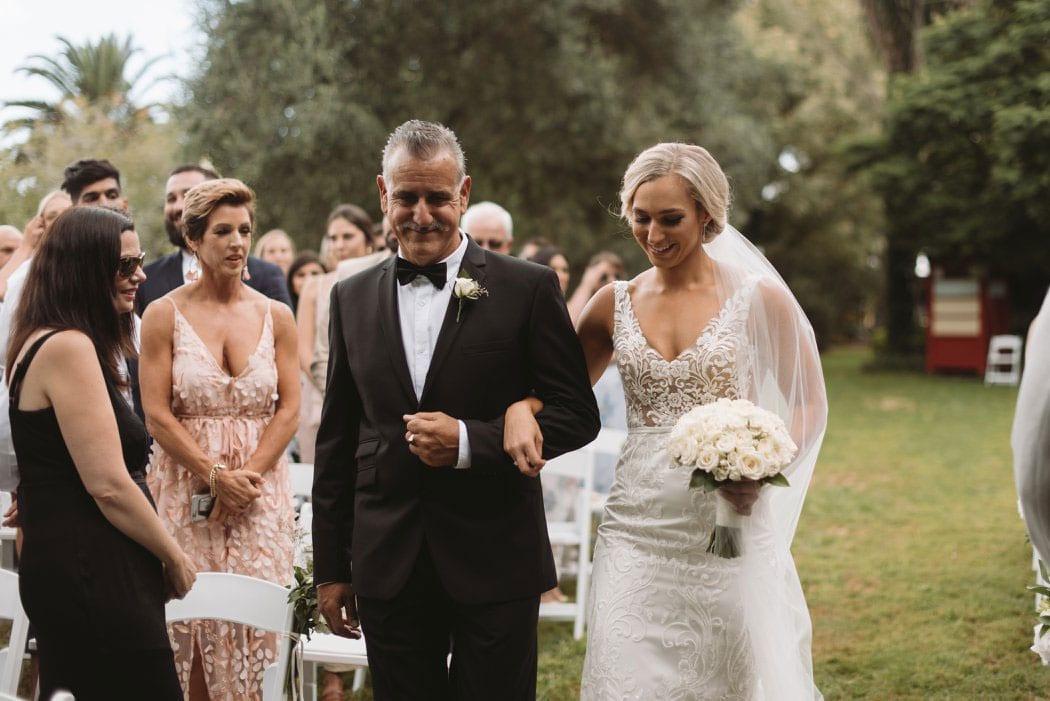 Real Weddings | Vinka Design | Real Brides Wearing Vinka Gowns | Nikki and Korey - Nikki being walked down the aisle her beautiful bespoke gown shiig