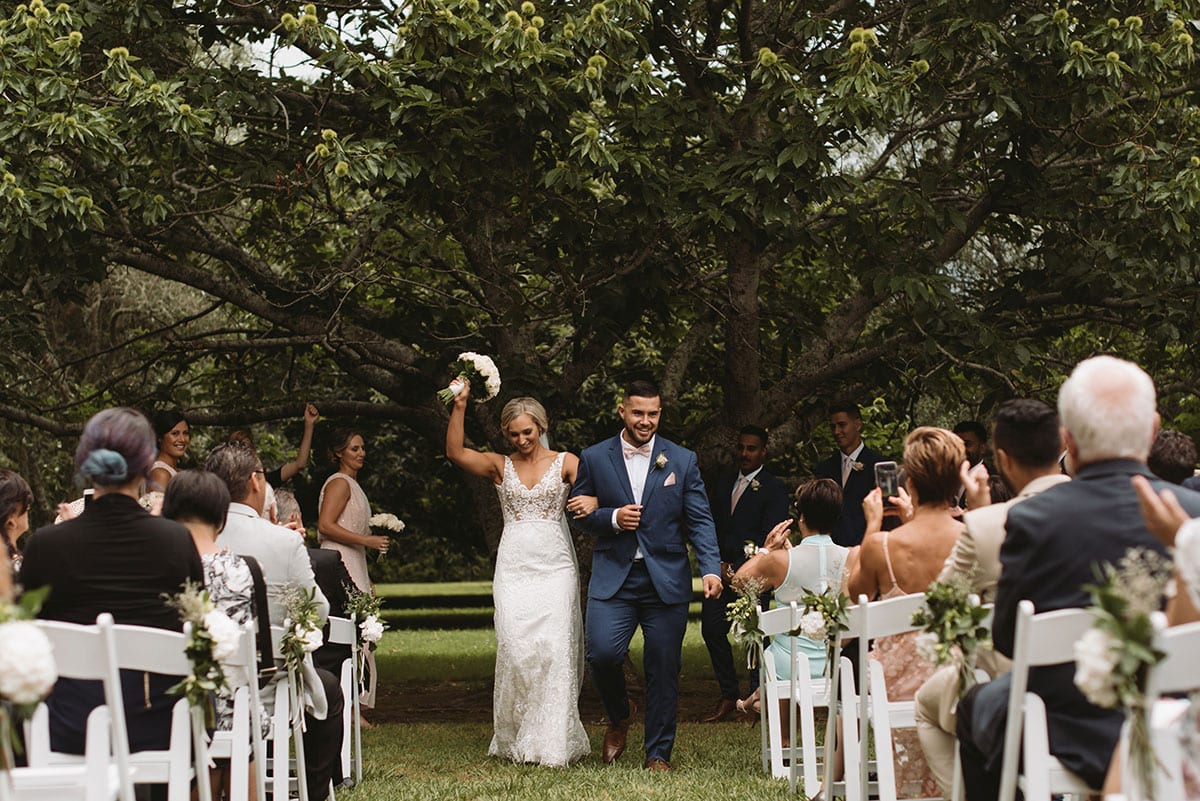 Real Weddings | Vinka Design | Real Brides Wearing Vinka Gowns | Nikki and Korey just married walking down aisle