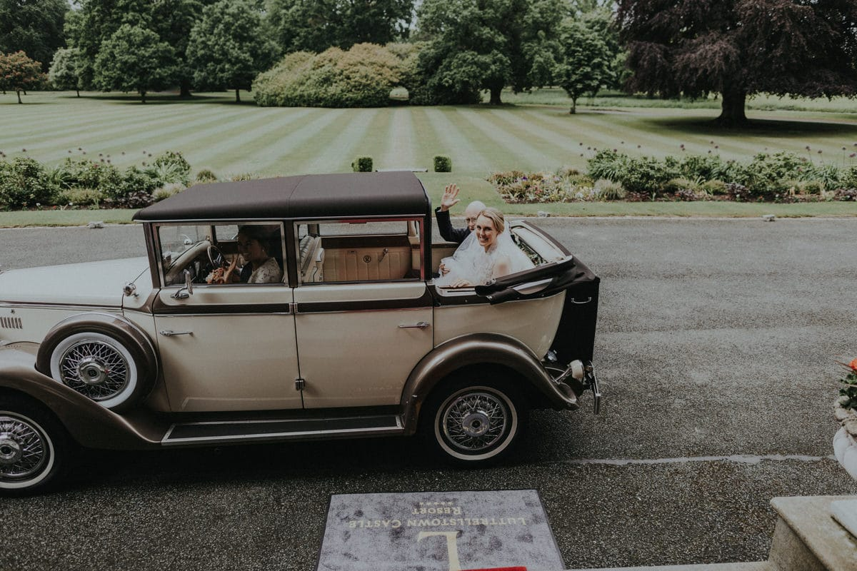 Real Weddings | Vinka Design | Real Brides Wearing Vinka Gowns | Paige and Ciaran classic wedding car arrival