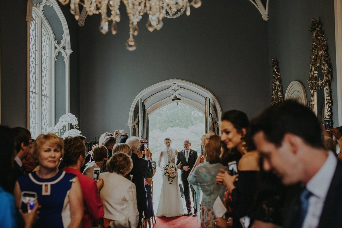 Real Weddings | Vinka Design | Real Brides Wearing Vinka Gowns | Paige and Ciaran - Paige entering chapel in doorway