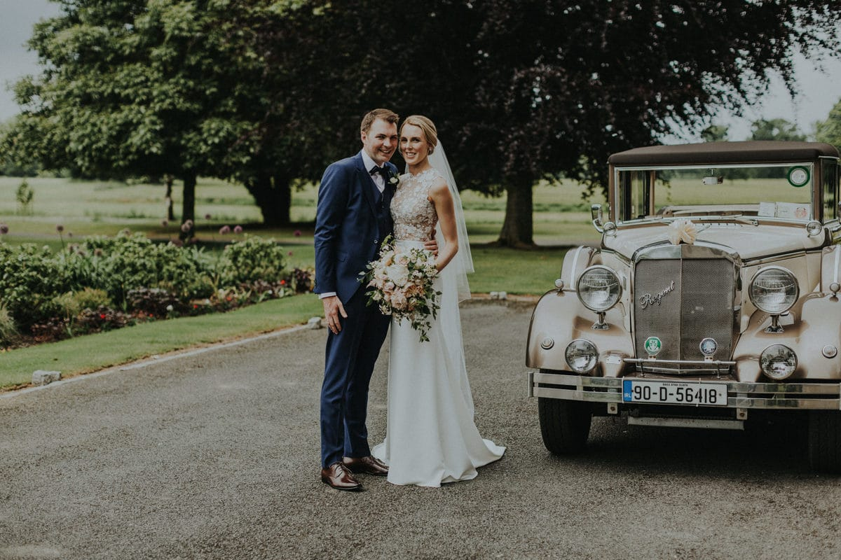 Real Weddings | Vinka Design | Real Brides Wearing Vinka Gowns | Paige and Ciaran with classic wedding car