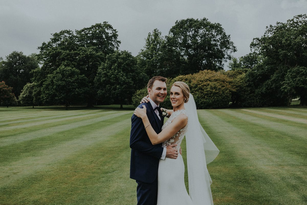 Real Weddings | Vinka Design | Real Brides Wearing Vinka Gowns | Paige and Ciaran embracing