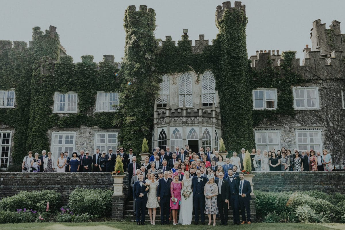 Real Weddings | Vinka Design | Real Brides Wearing Vinka Gowns | Paige and Ciaran wedding guests outside Irish castle