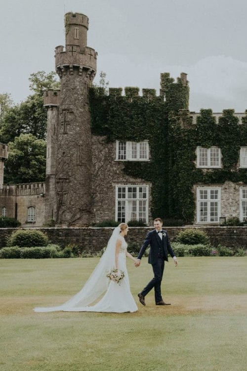 Real Weddings | Vinka Design | Real Brides Wearing Vinka Gowns | Paige and Ciaran - walk along outside castle