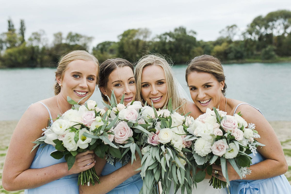 Real Weddings | Vinka Design | Real Brides Wearing Vinka Gowns | Olivia and Brayden - Olivia with bridesmaids next to river