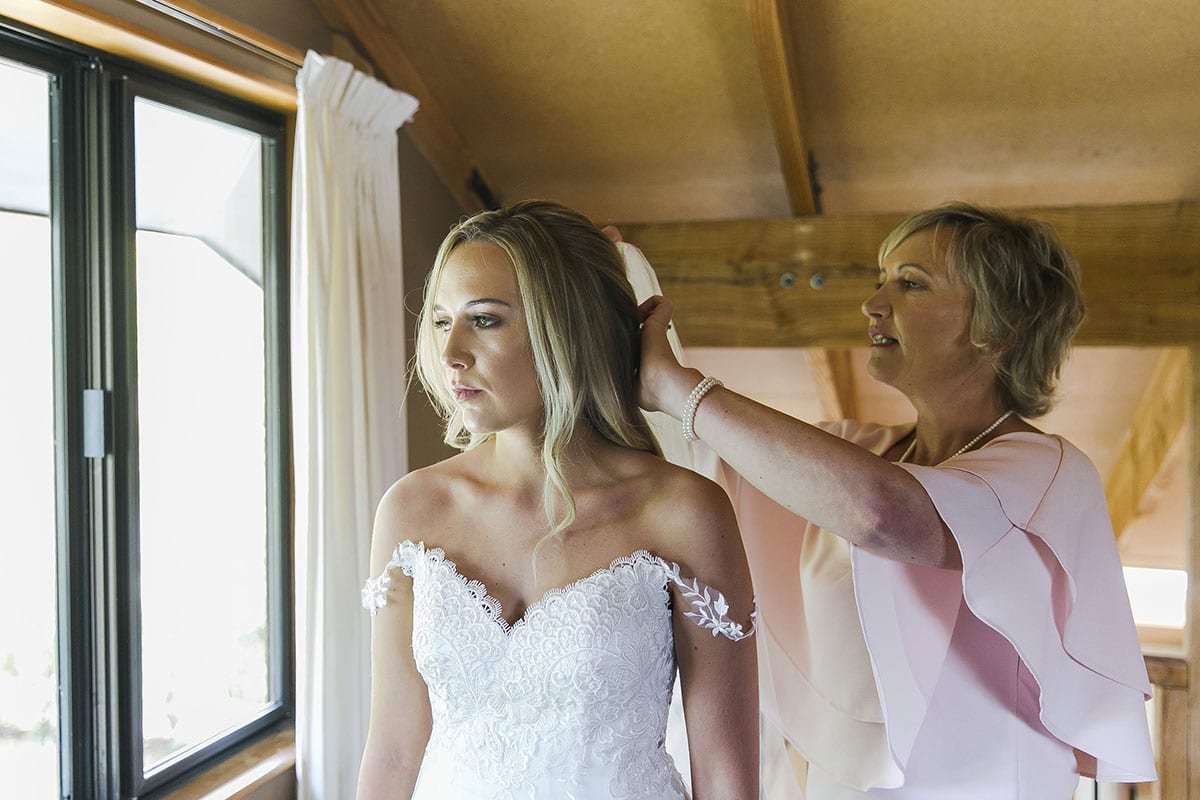 Real Weddings | Vinka Design | Real Brides Wearing Vinka Gowns | Olivia and Brayden bespoke veil being fitted