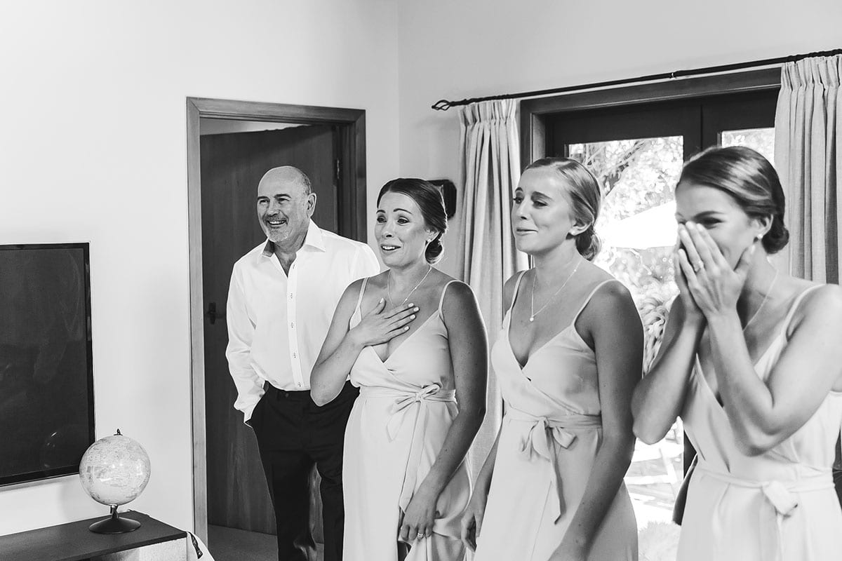 Real Weddings | Vinka Design | Real Brides Wearing Vinka Gowns | Olivia and Brayden bridesmaids delight at seeing Olivia's dress for the first time