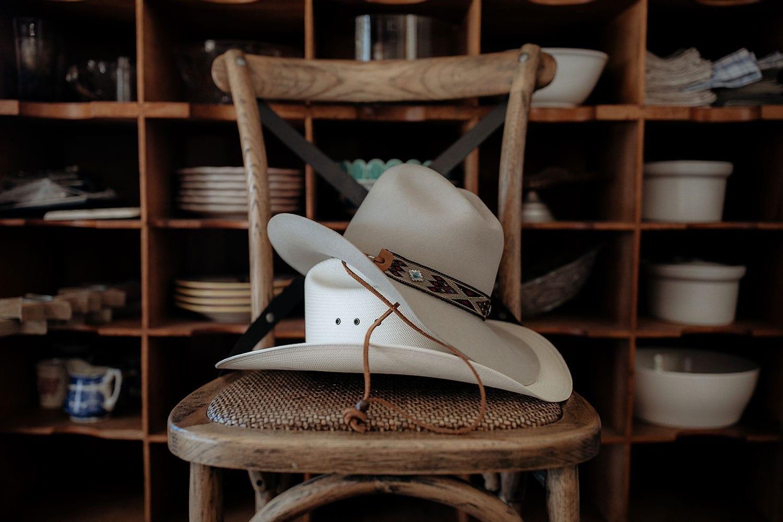 Vinka Design Features Real Weddings - Vinka Design Features Real Weddings - cowboy hats on chair
