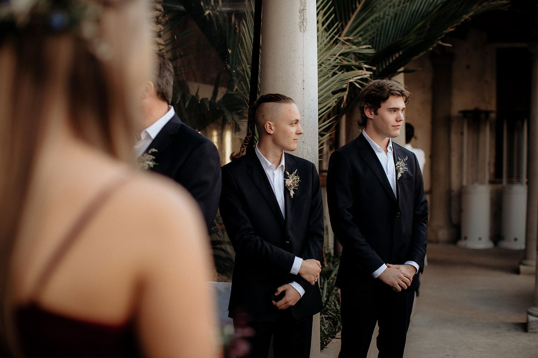 Vinka Design Features Real Weddings - Vinka Design Features Real Weddings - groomsmen at ceremony