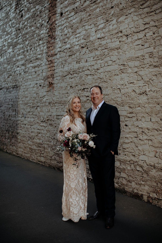 Vinka Design Features Real Weddings - Vinka Design Features Real Weddings - Jan in custom designed wedding dress holding bouquet with Steve