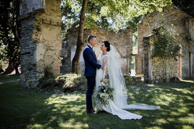 Vinka Design Features Real Weddings - bride in bespoke custom made gown with groom in sunlit building ruins in Queenstown
