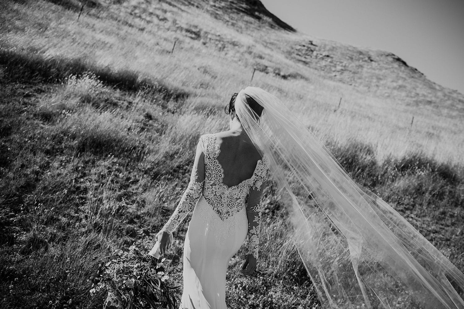 Vinka Design Features Real Weddings - bride in bespoke custom made gown, low back with lace detail and veil