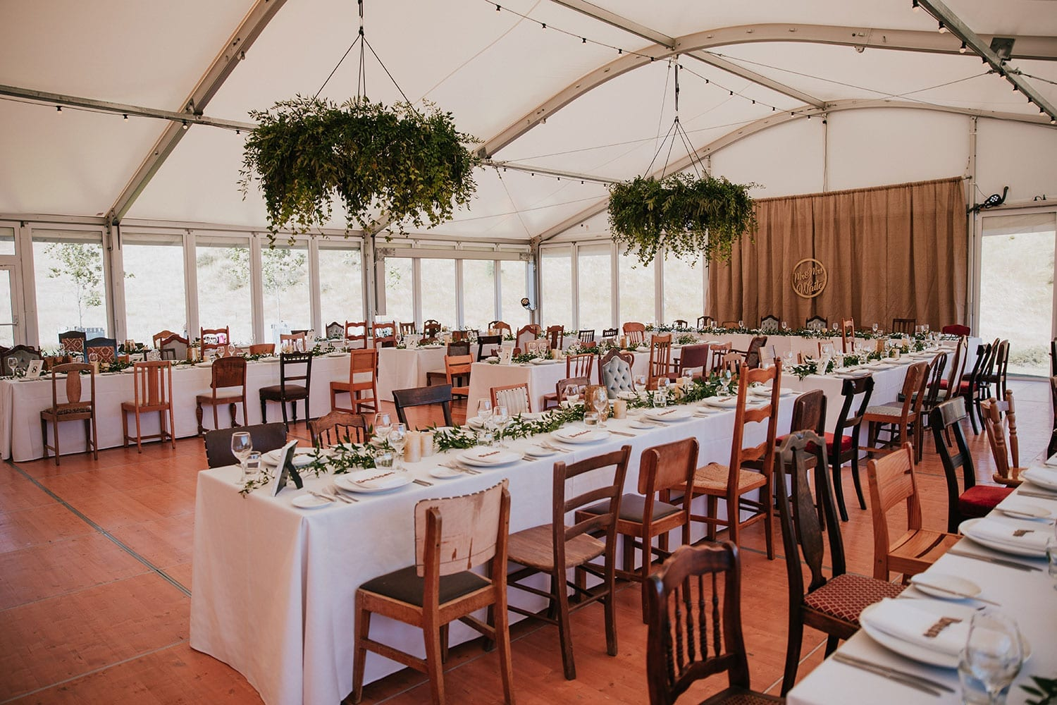 Vinka Design Features Real Weddings - reception with tables set up