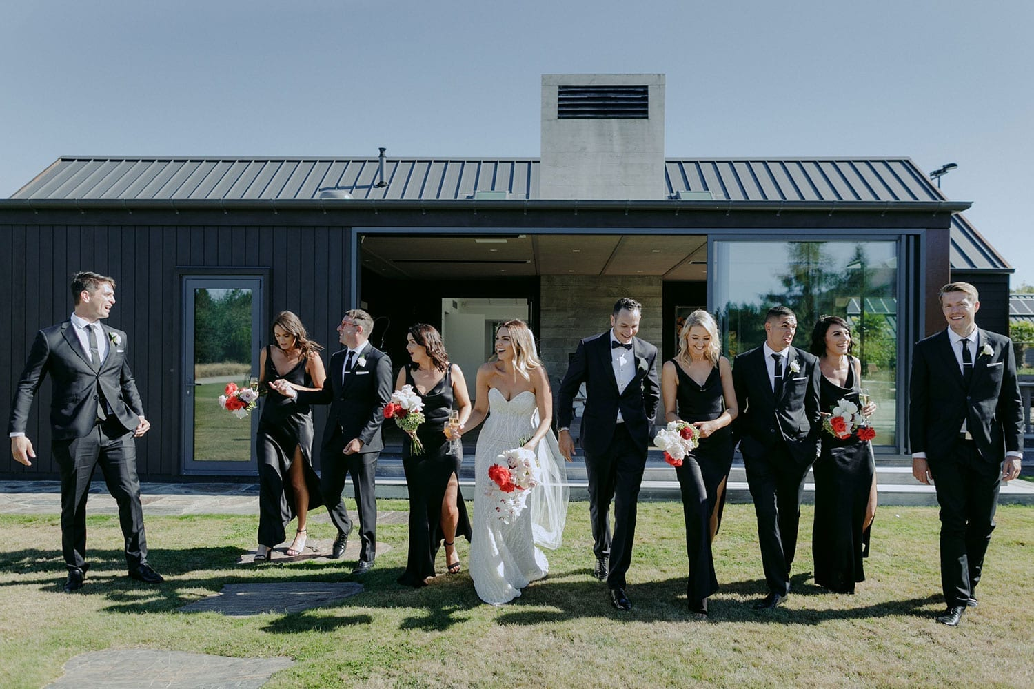 Vinka Design Features Real Weddings - bride in custom made gown, a combination of our Indi wedding dress with added beading appliqued and sewn by hand, over the top of a nude semi sheer base. With bridal party in line