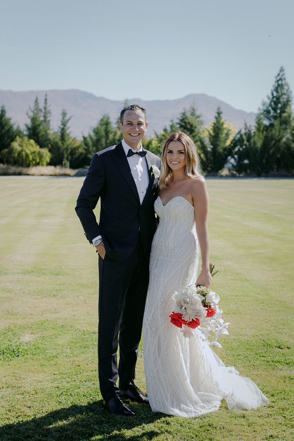 Vinka Design Features Real Weddings - bride in custom made gown, a combination of our Indi wedding dress with added beading appliqued and sewn by hand, over the top of a nude semi sheer base. With groom full length