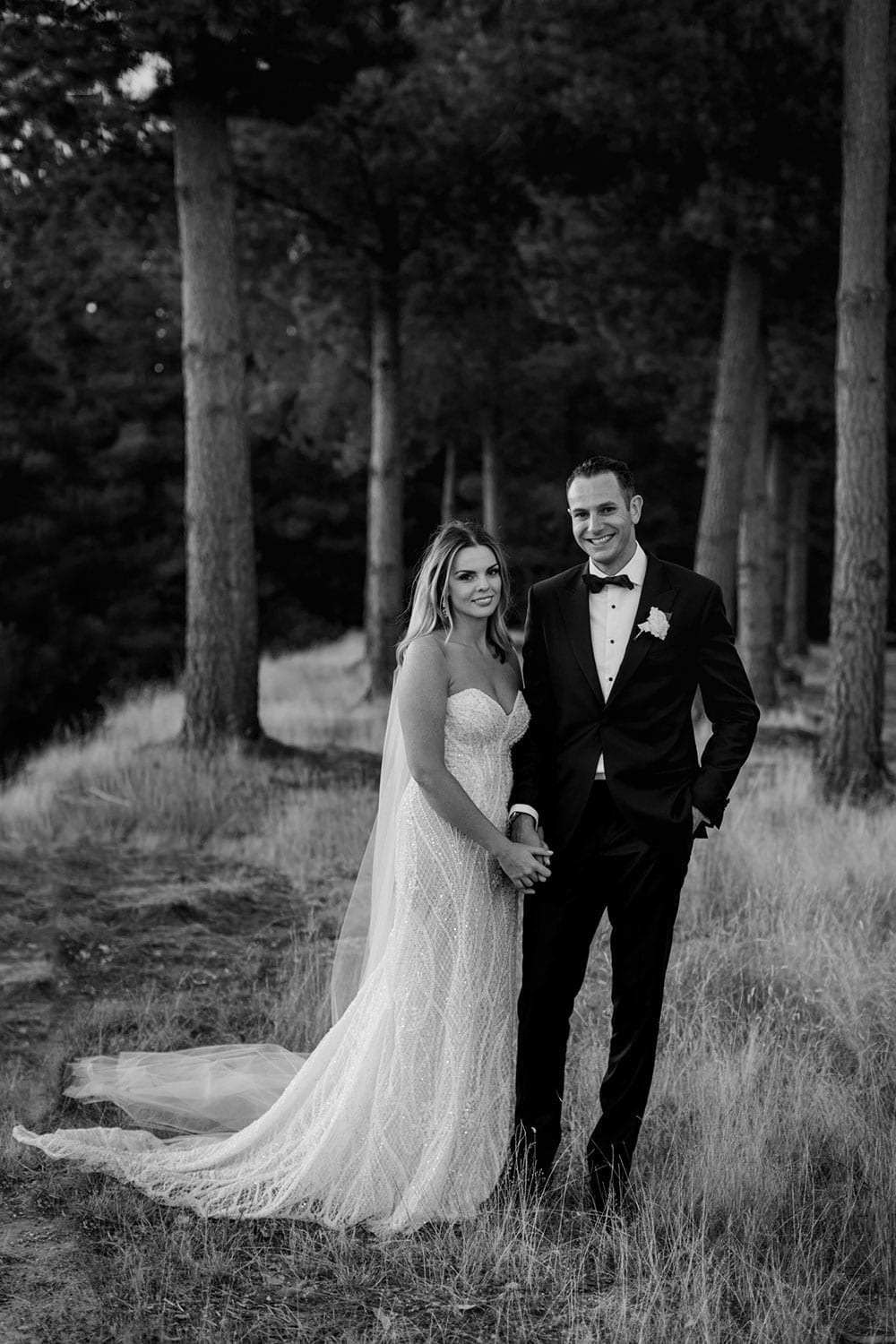 Vinka Design Features Real Weddings - bride in custom made gown, a combination of our Indi wedding dress with added beading appliqued and sewn by hand, over the top of a nude semi sheer base. With groom in woods in black and white