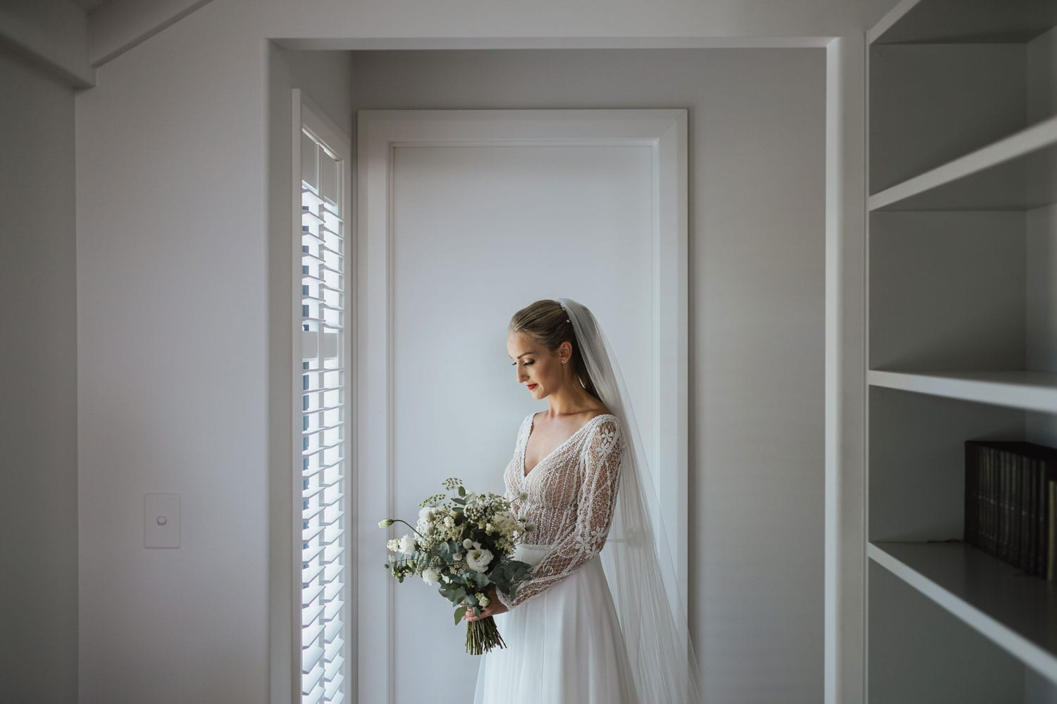 Vinka Design Features Real Weddings - Bride in custom made gown with bold lace bodice with fitted, long, beaded lace sleeves