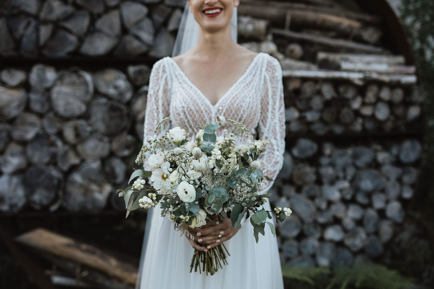 Vinka Design Features Real Weddings - Bride in custom made gown with bold lace bodice with fitted, long, beaded lace sleeves. Bouquet