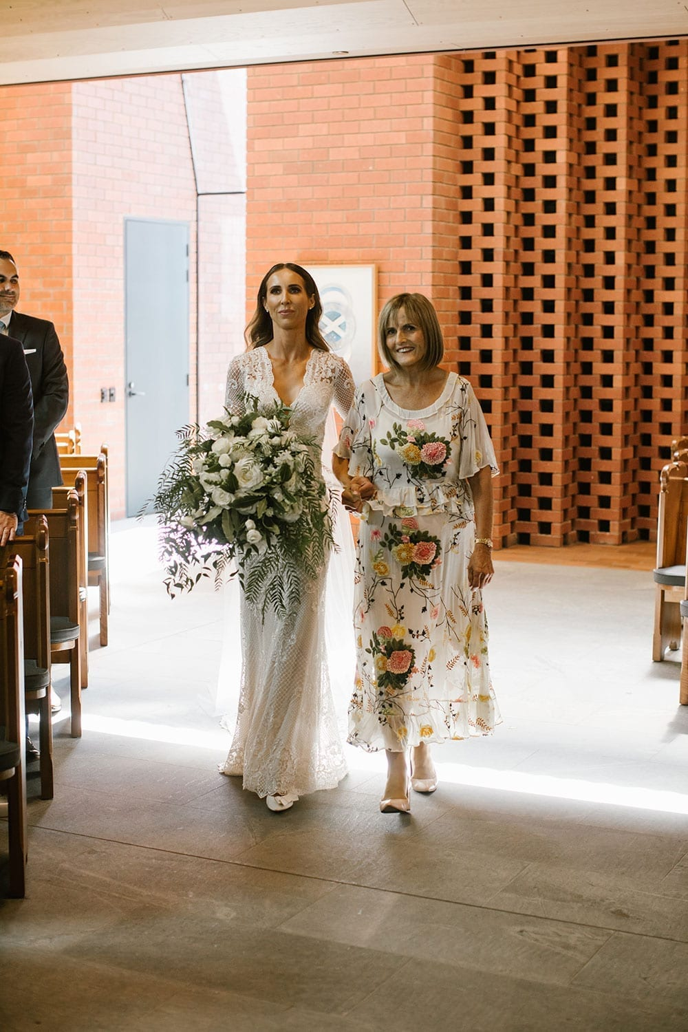 Vinka Design Features Real Weddings - Bride in bespoke fitted lace gown walking down aisle