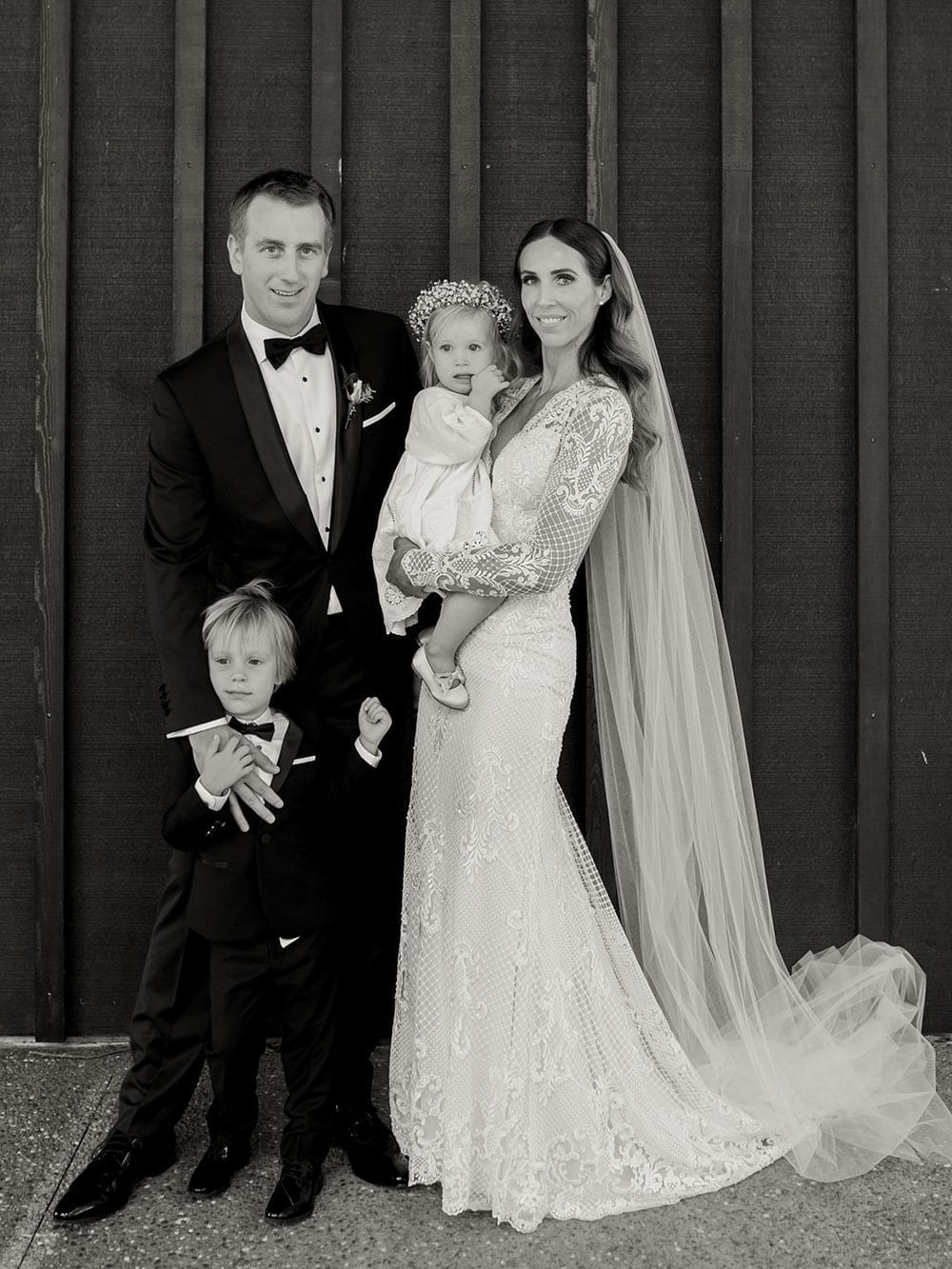 Vinka Design Features Real Weddings - Bride in bespoke fitted lace gown with family - in black and white
