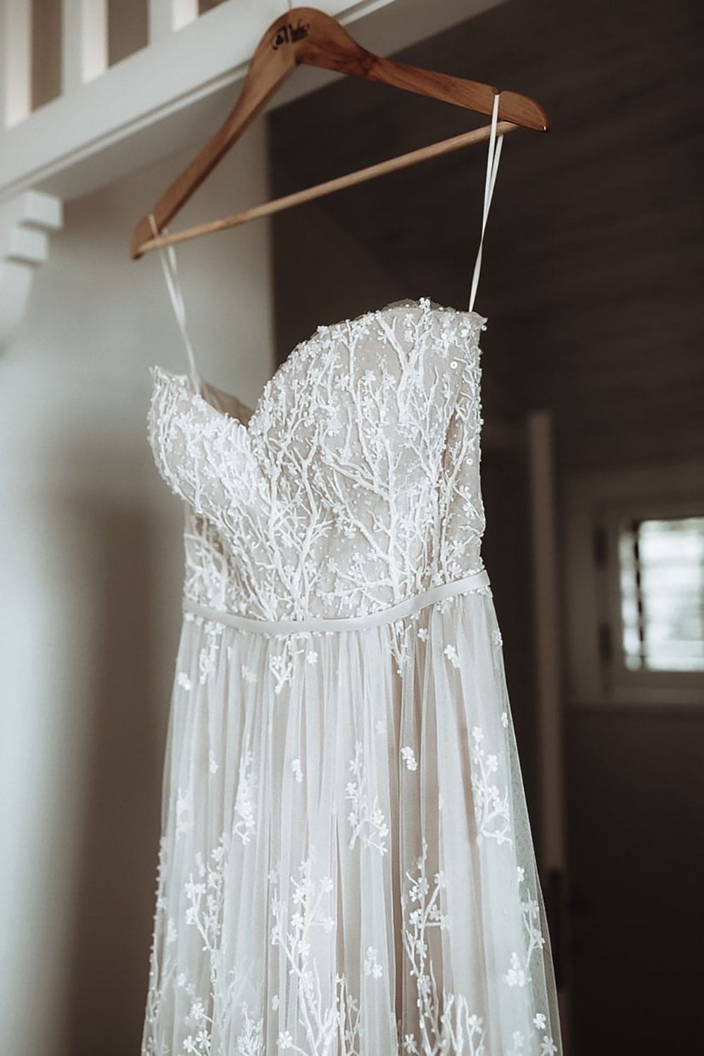 Vinka Design Features Real Weddings - custom made strapless beaded lace dress. Hanging